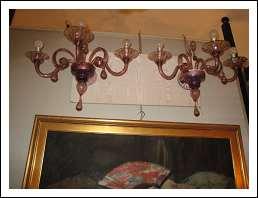 Coppia di appliques a tre luci Art Decò .